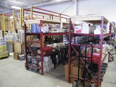 Shelves overflowing with parts.